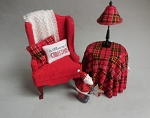 RED & PLAID CHAIR, SKIRTED TABLE & LAMP