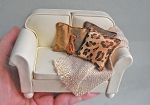 IVORY 'LEATHER' LOVE SEAT