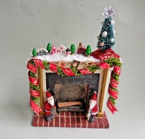 DECORATED FIREPLACE WITH CHRISTMAS VILLAGE